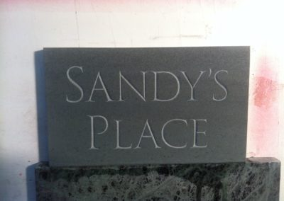 Green slate house sign