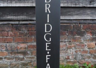 Bespoke Welsh slate house sign with Gold dish in place