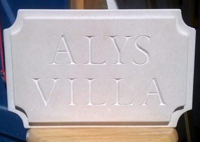 Bespoke Portland limestone house sign with dropped border