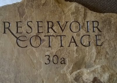 Rustic York sandstone house sign with brown letters