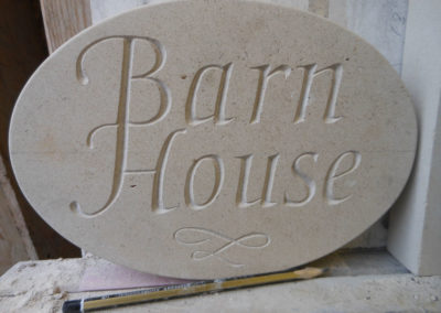 Portland limestone oval house sign