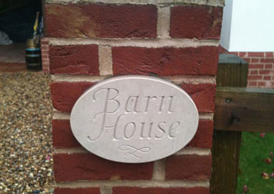 Portland limestone oval house sign in place