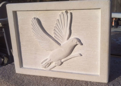 Portland limestone dove carving in deep relief