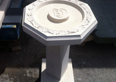 Portland limestone birdbath with ivy leaves carved around the border