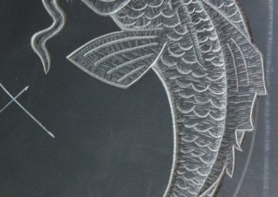 Relief carving of fish on Welsh slate