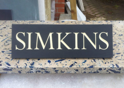 Black slate house sign with ivory letters