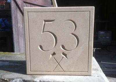 Portland limestone house numbers with hammers design