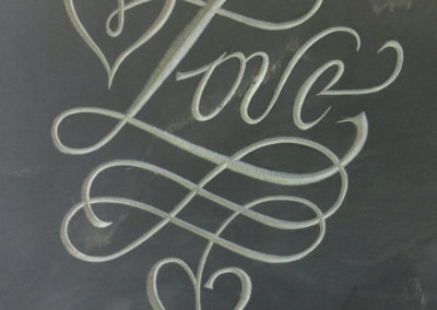 Love in a calligraphy style font on welsh slate