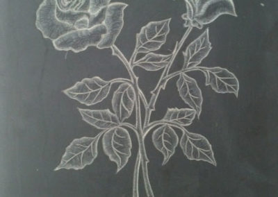 Rose carving on Welsh slate