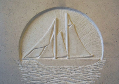 Boat carving in relief on a Portland limestone headstone