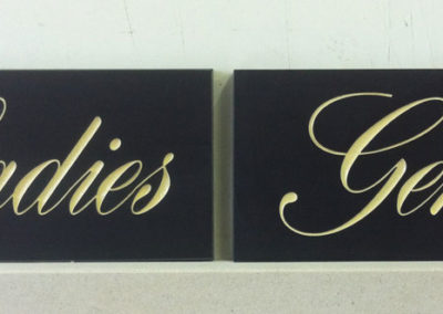 Ladies and Gents toilette signs for a refurbish present on welsh slate