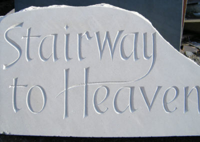 Carved Portland limestone sign for a new part of the house