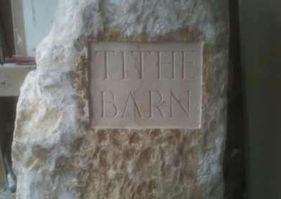 Rustic limestone boulder house sign