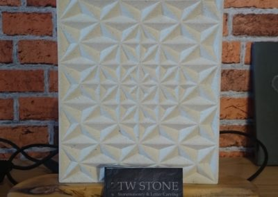 Portland Limestone desk ornament with hand carved triangle pattern with wooden base